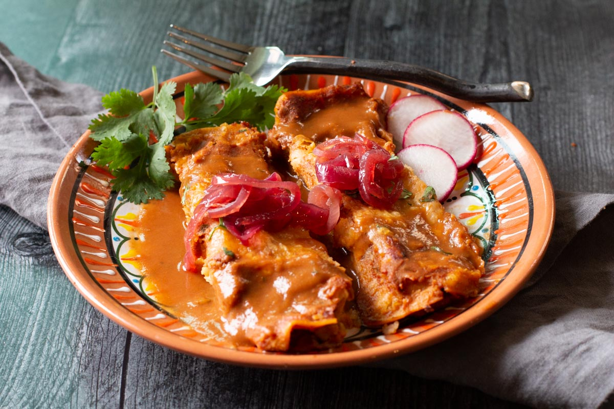 Cochinita Pibel Pulled Pork Enchiladas On A Mexican Plate