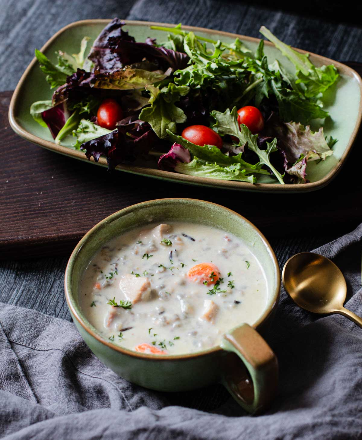 Creamy chicken and wild rice soup served with a side salad