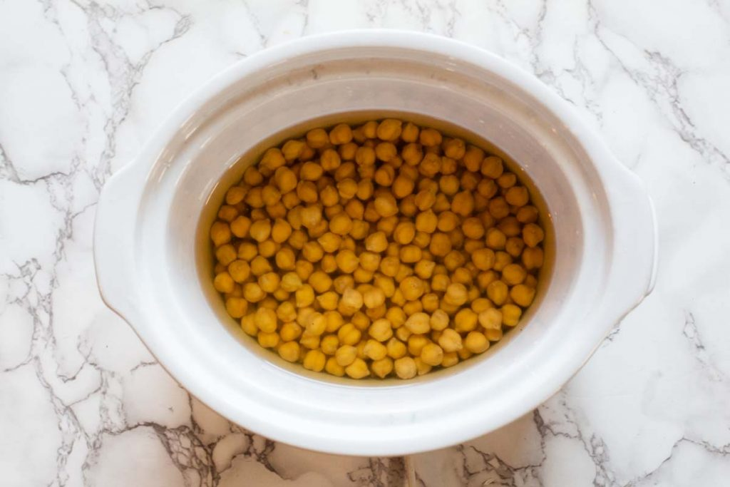soaking dried chickpeas to make hummus