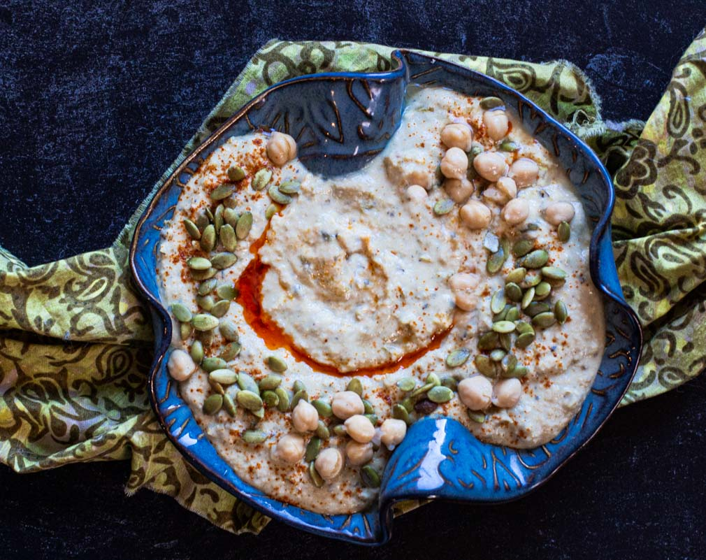 Spicy Hummus Recipe made with Hatch Green Chile Peppers, topped with pepitas and chickpeas
