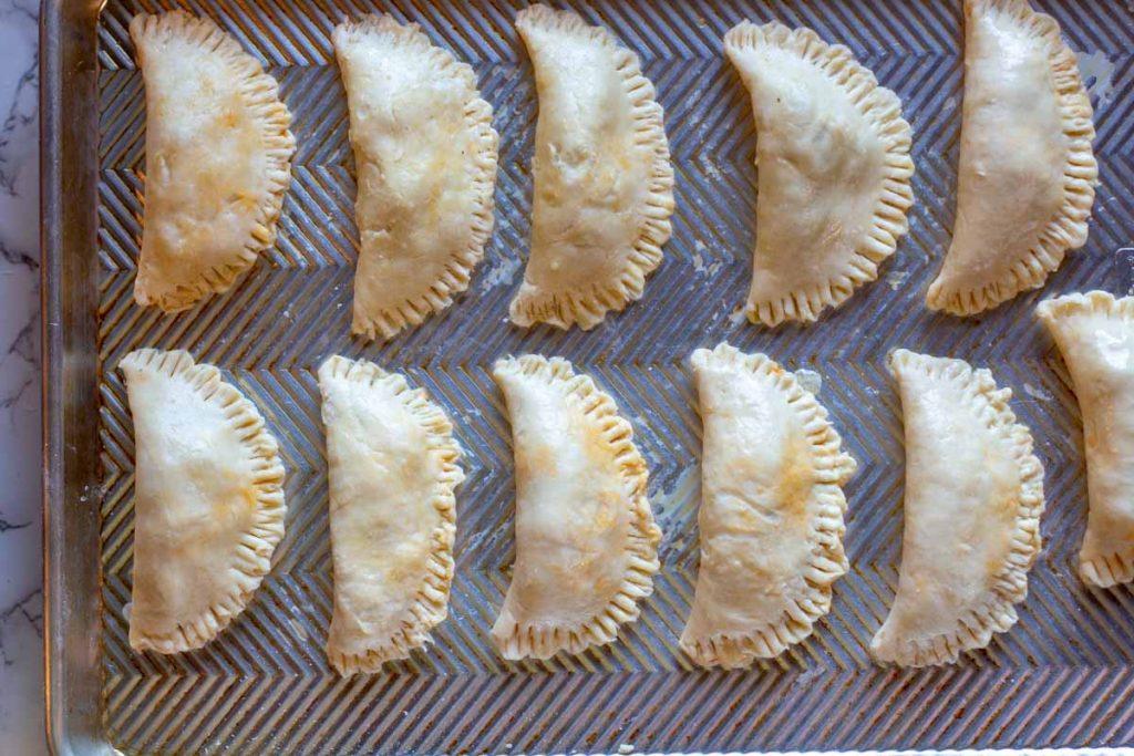 Empanadas made with cream cheese dough ready to bake