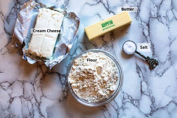 Ingredients to make cream cheese empanada dough