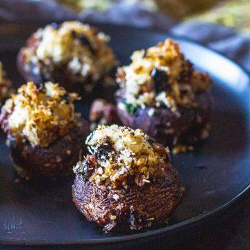 Stuffed mushrooms served on a black plate