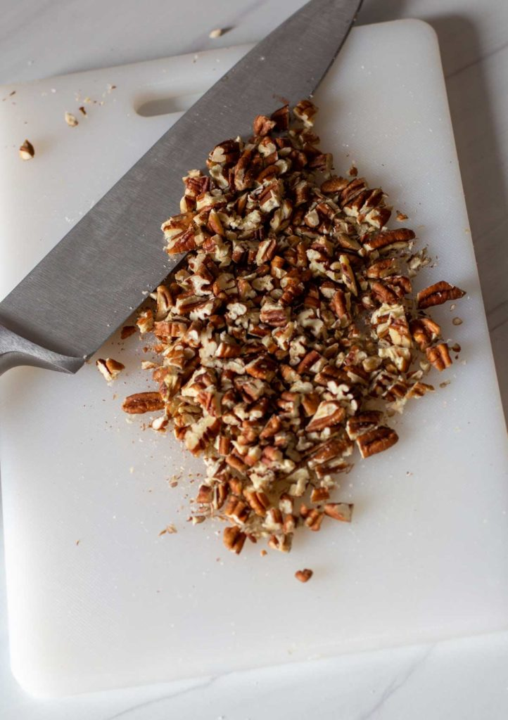 Using a chef knife to chop pecans
