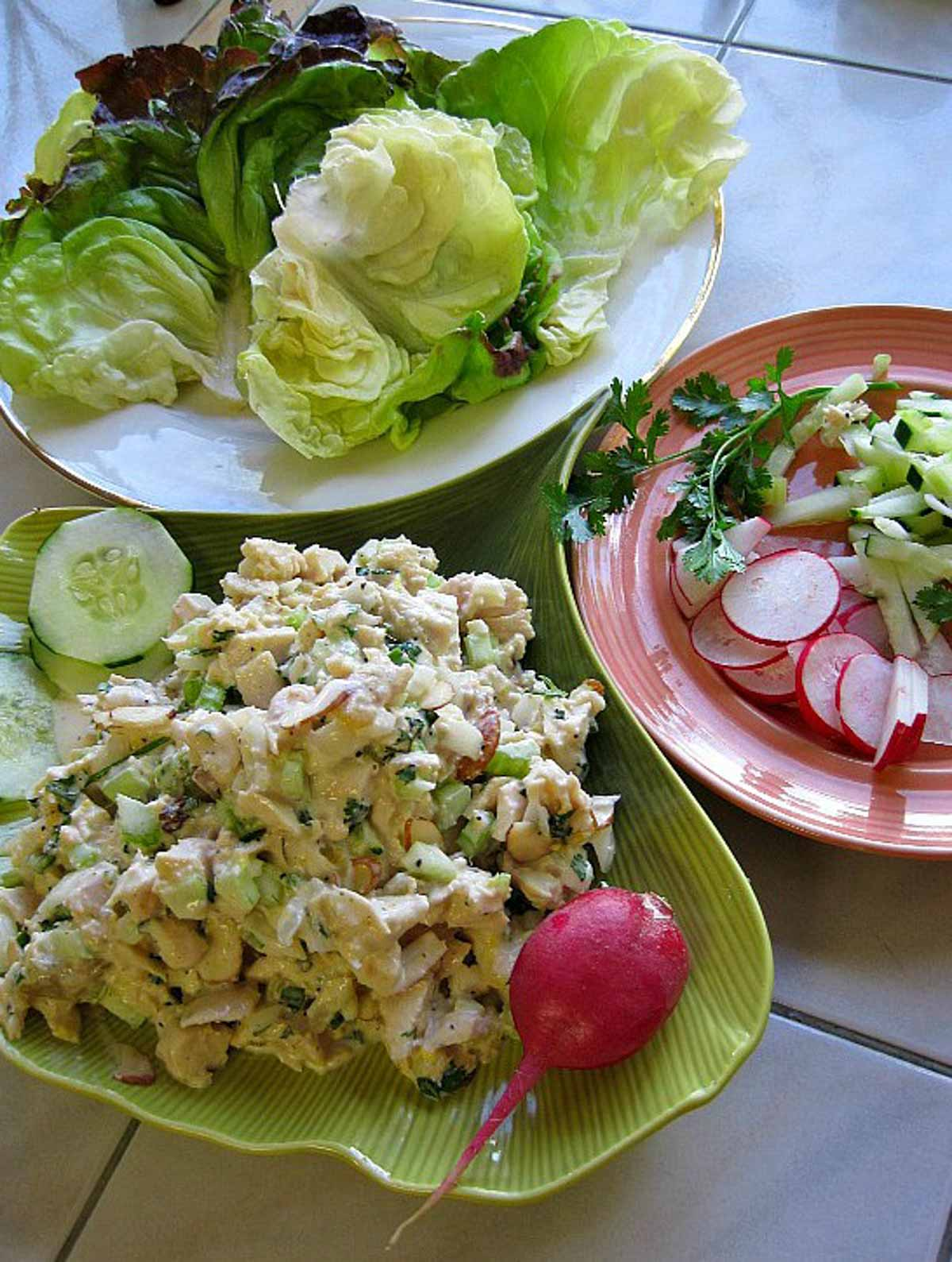 Chicken salad lettuce wraps with radishes, cucumber and cilantro.