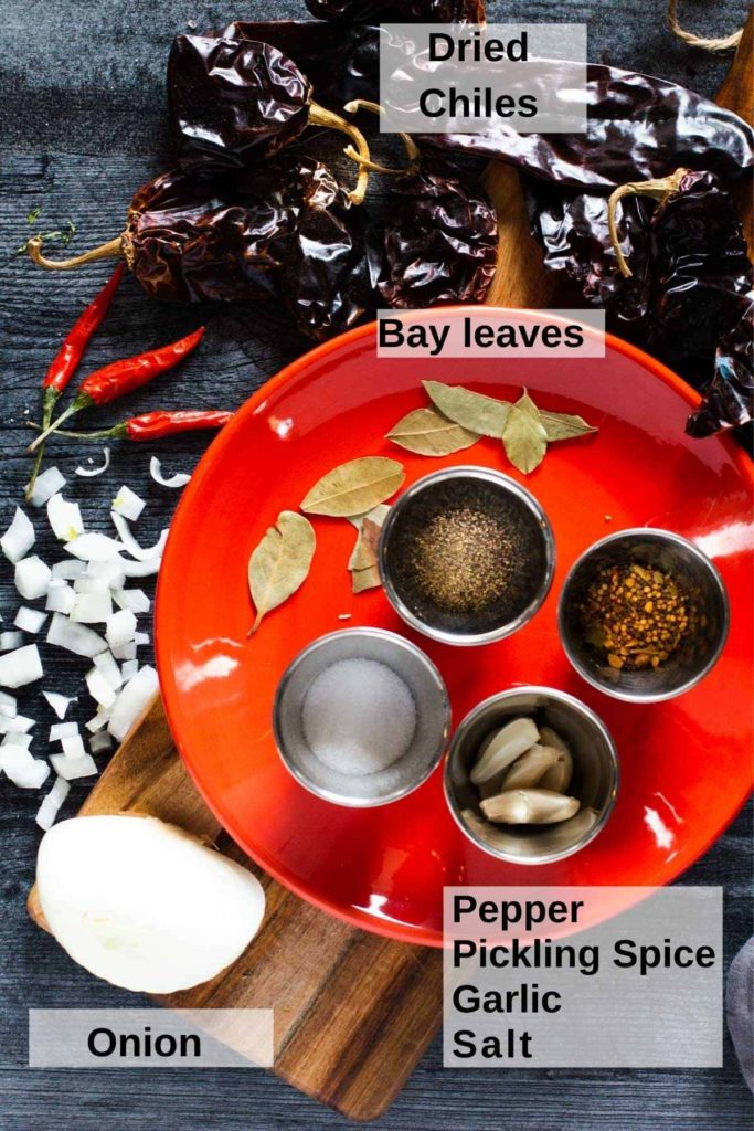 Ingredients used to make chicken barbacoa. Dried Chile Pods, onion and spices