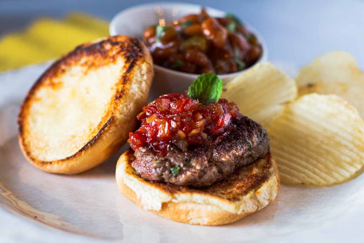 Lamb burgers with mint and topped with Tomato Chutney. Served with Baked beans