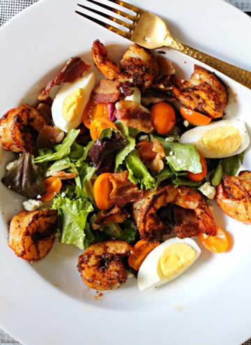 Blackened shrimp over spring greens with cherry tomatoes, hard boiled eggs, bacon and champagne vinaigrette