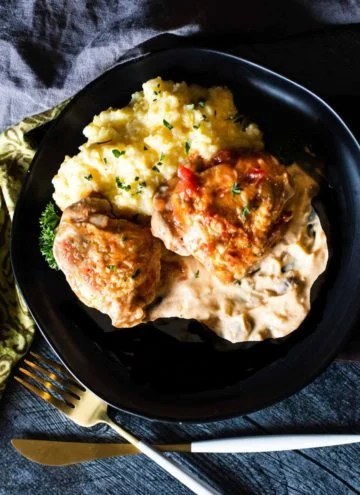Braised chicken thighs with creamy tequila sauce served with polenta