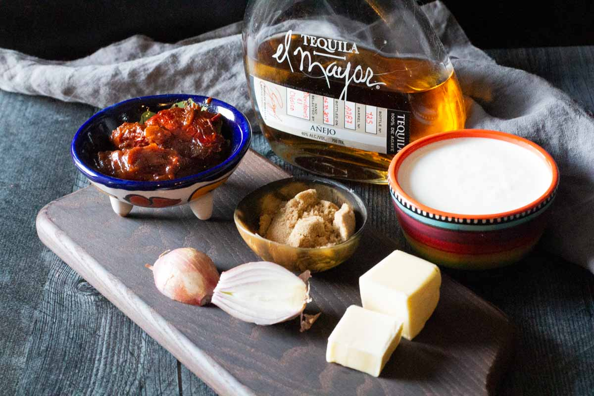 Ingredients to make creamy tequila sauce