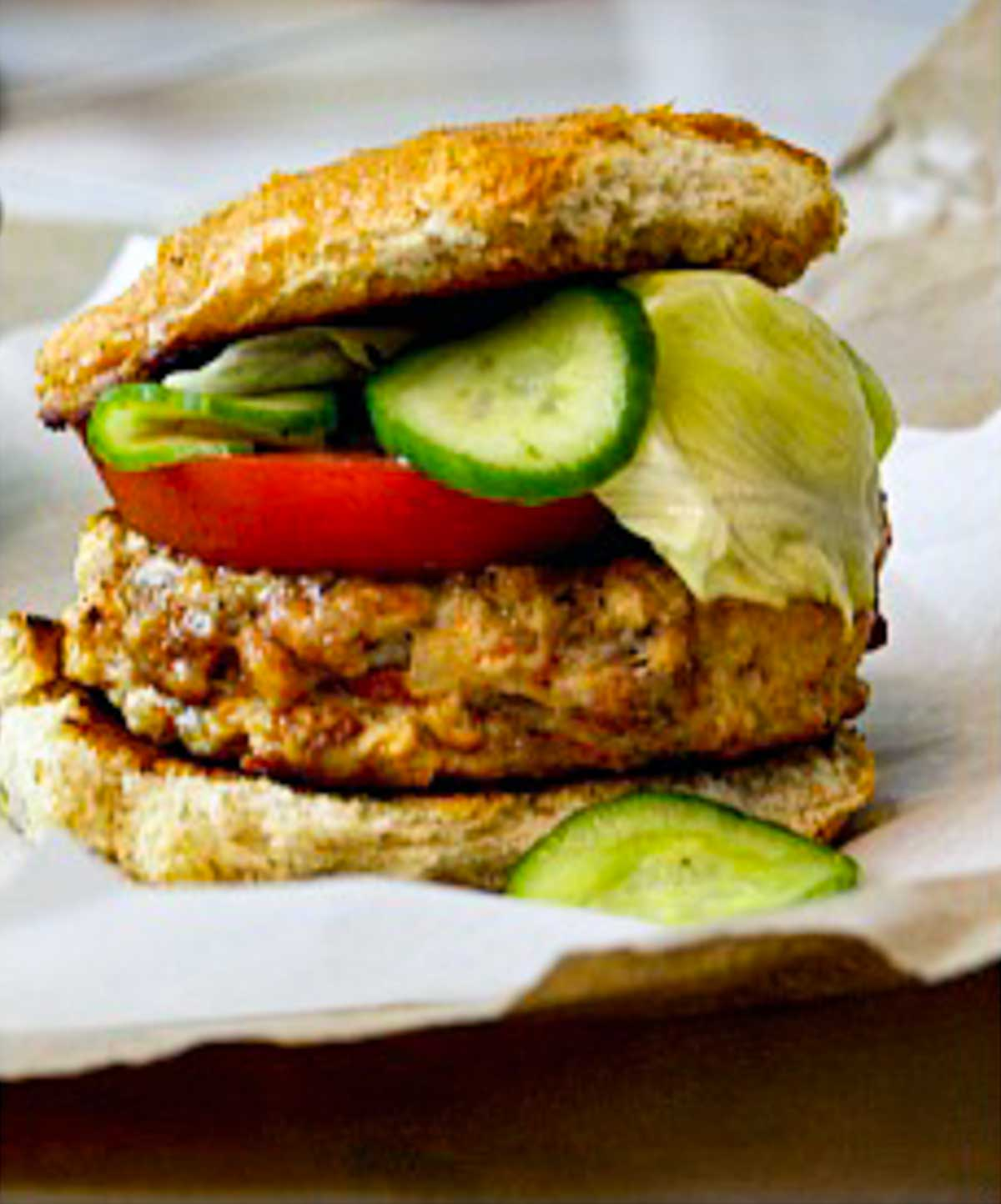 Ground chicken and chorizo burgers with topped with cumin lime quick pickles