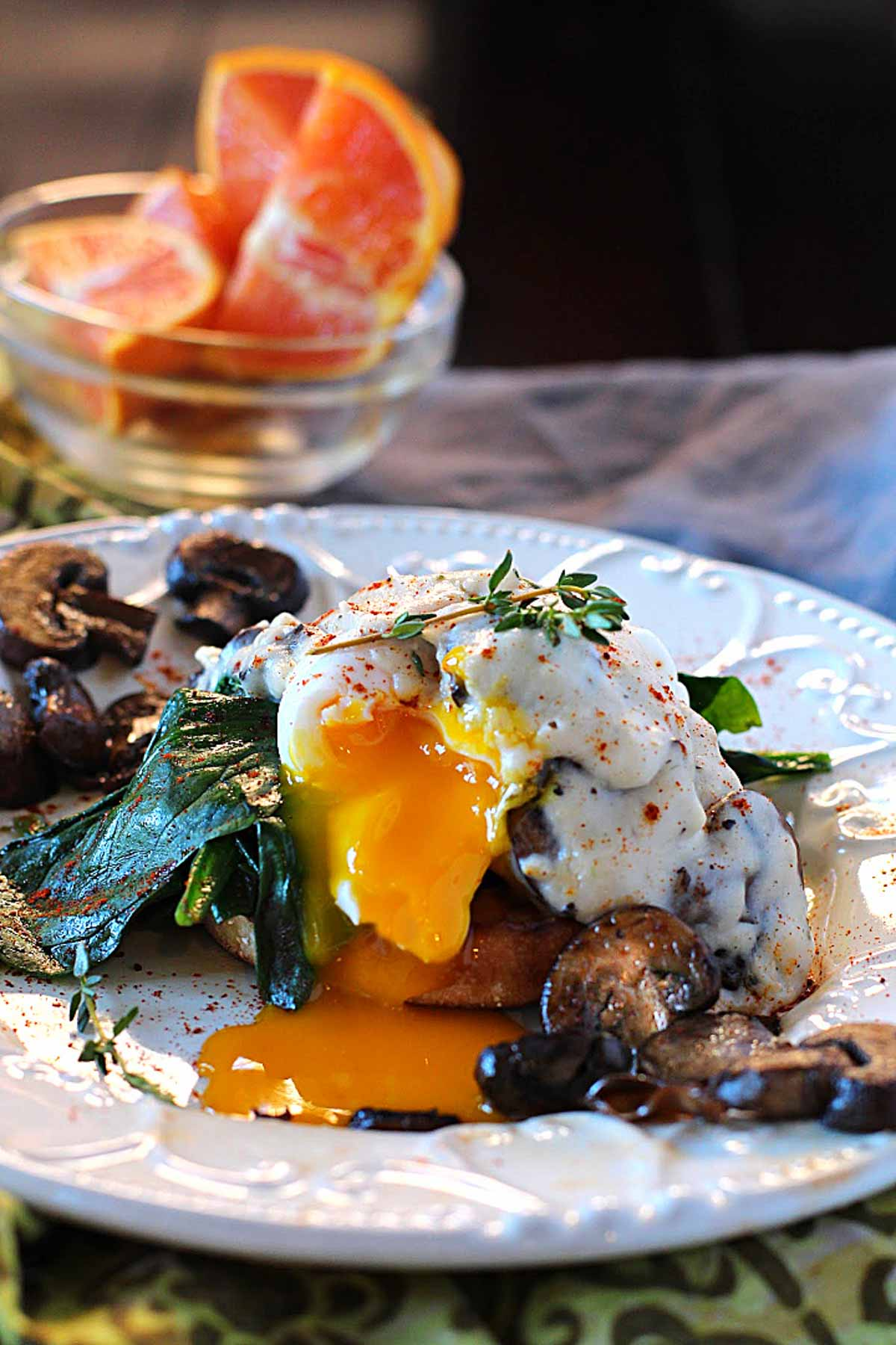 Eggs benedict with mushrooms, spinach and gravy