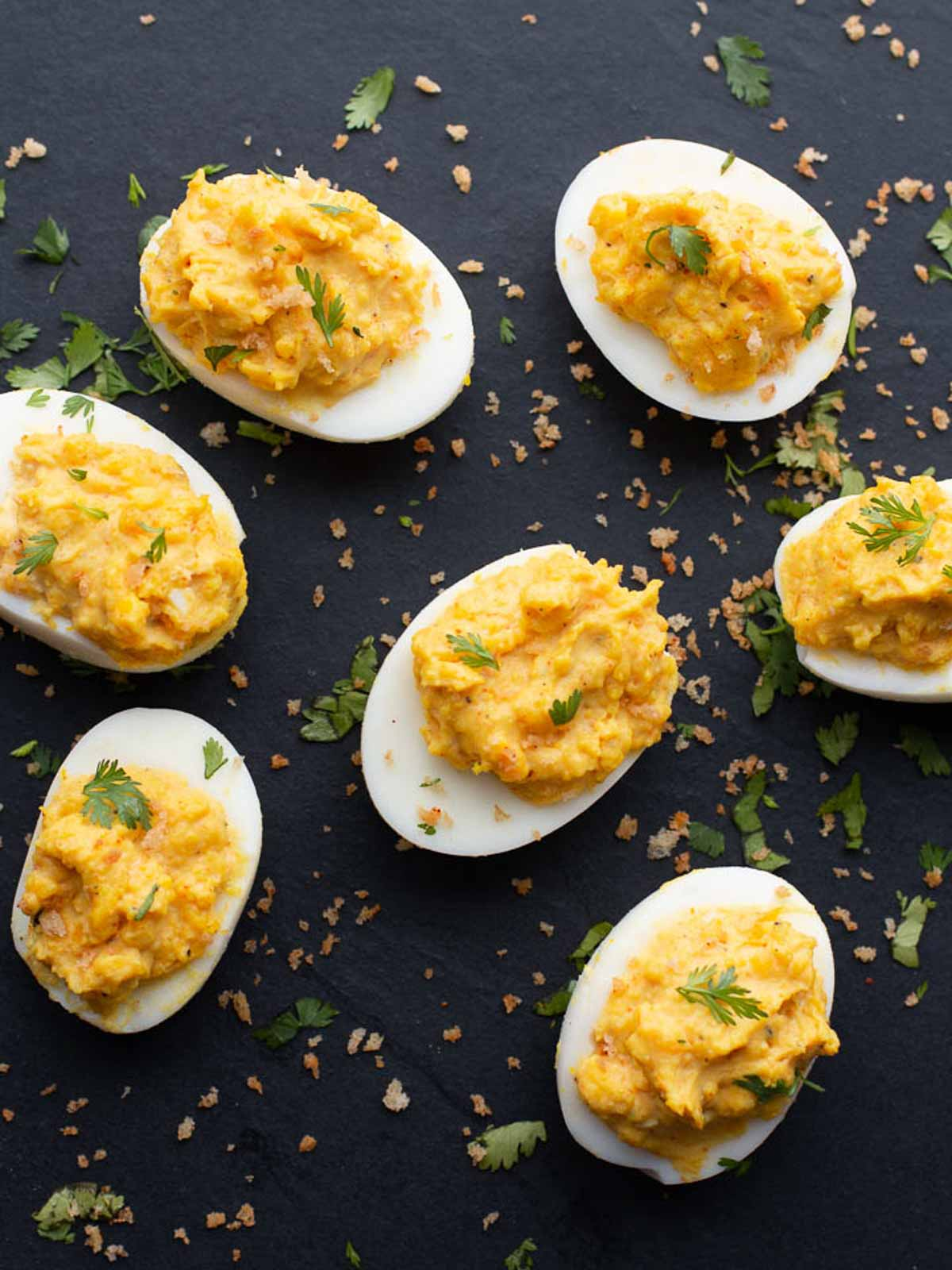 Spicy deviled eggs topped with cilantro and spicy panko bread crumbs