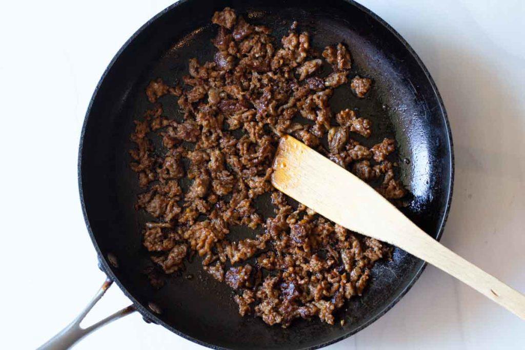 browning chorizo in a fry pan