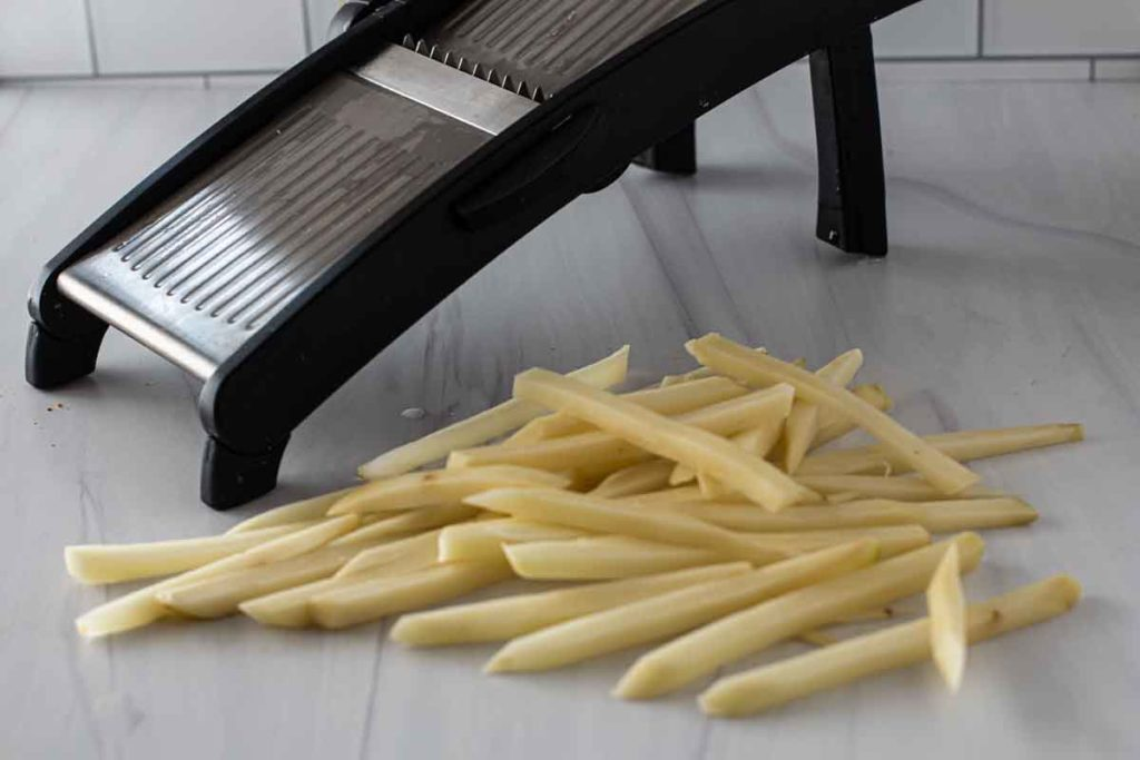 Cutting french fries with a mandolin