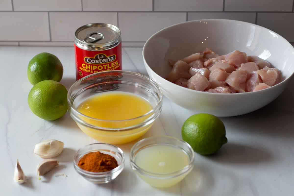 Ingredients to make easy ancho chili lime chicken kebabs