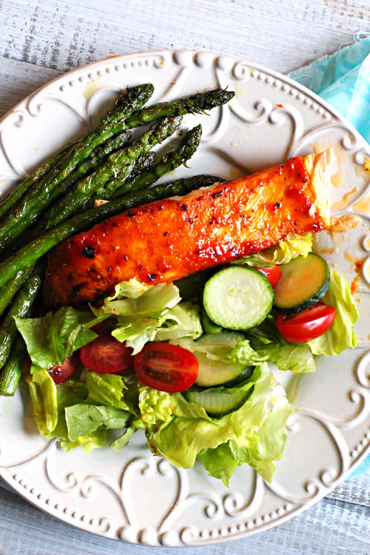 Peach Jam Glazed Salmon with a tossed green salad and sauteed asparagus.
