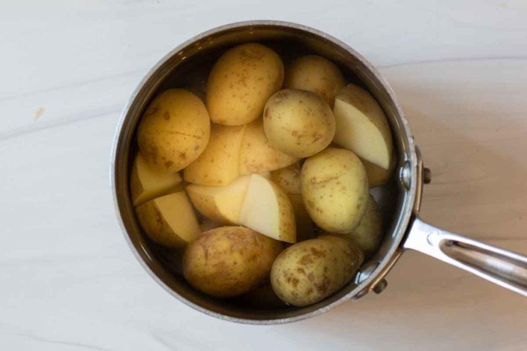 boiling yukon gold potatoes in a saucepan