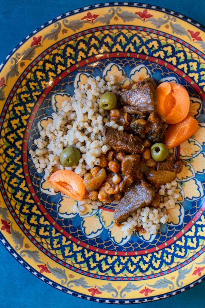 Lamb Tagine with apricots and olives served in a colorful moroccan bowl