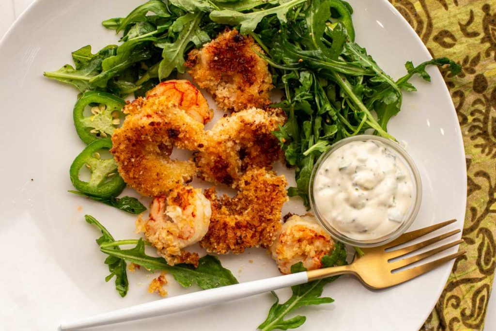 Baked shrimp breaded with panko and served with jalapeno lime aioli and arugula