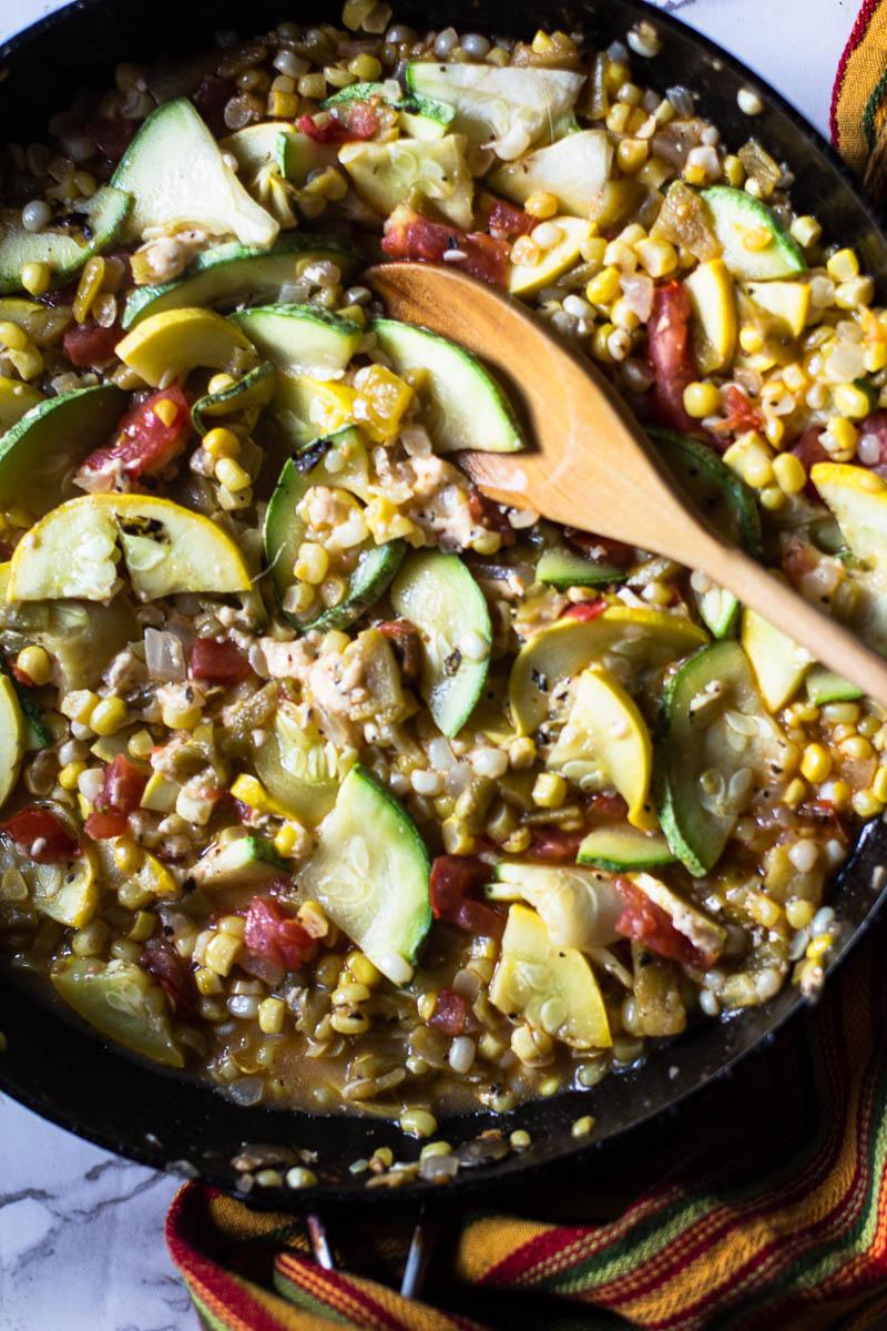 frying vegetables to make calabacitas
