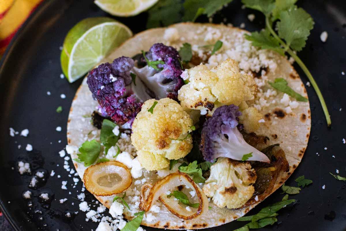 Roasted cauliflower tacos on a white corn tortilla