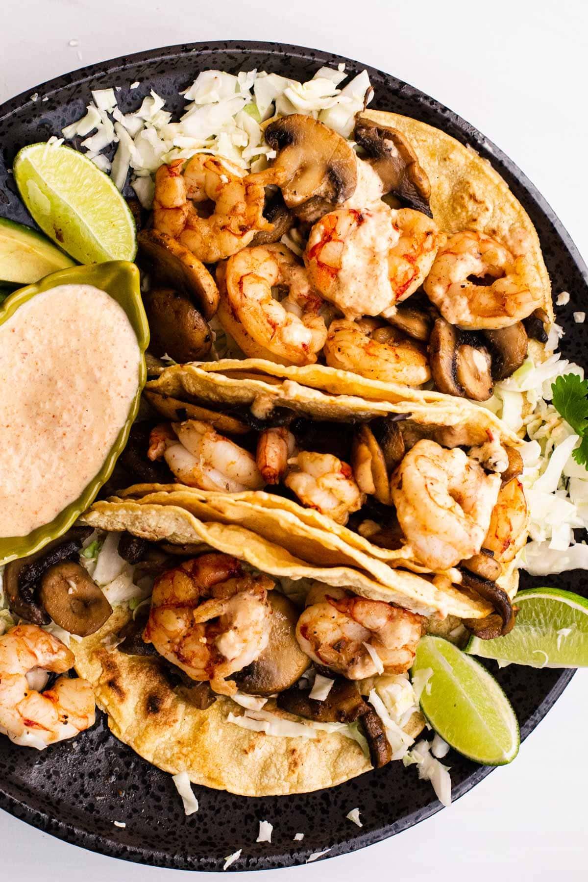 simple shrimp and mushroom tacos on corn tortillas with a creamy pineapple salsa.