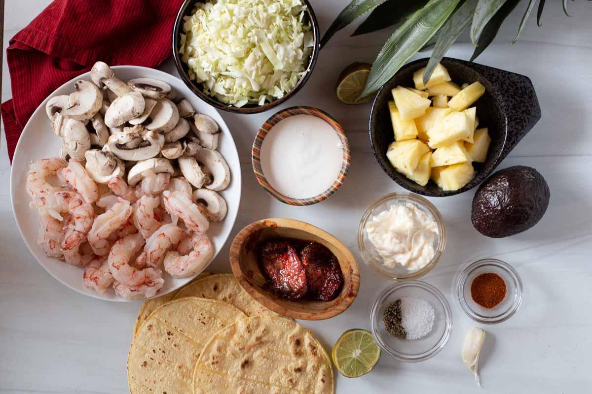Shrimp taco ingredients to make easy shrimp tacos with corn tortillas.