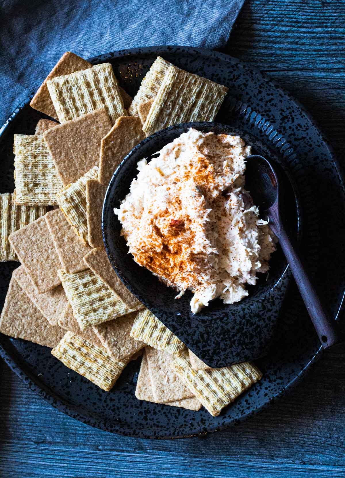 Chicken spread dip served with triscuits and wheat thin crackers.