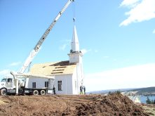 View of steeple in place on church