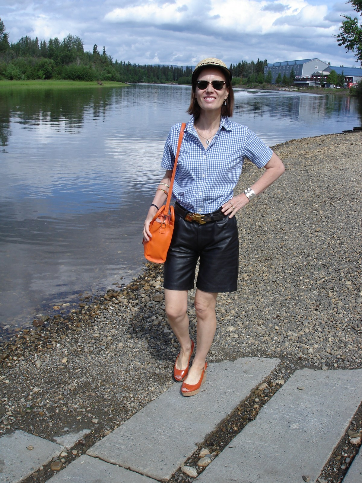mature woman wearing a picnic look with shorts