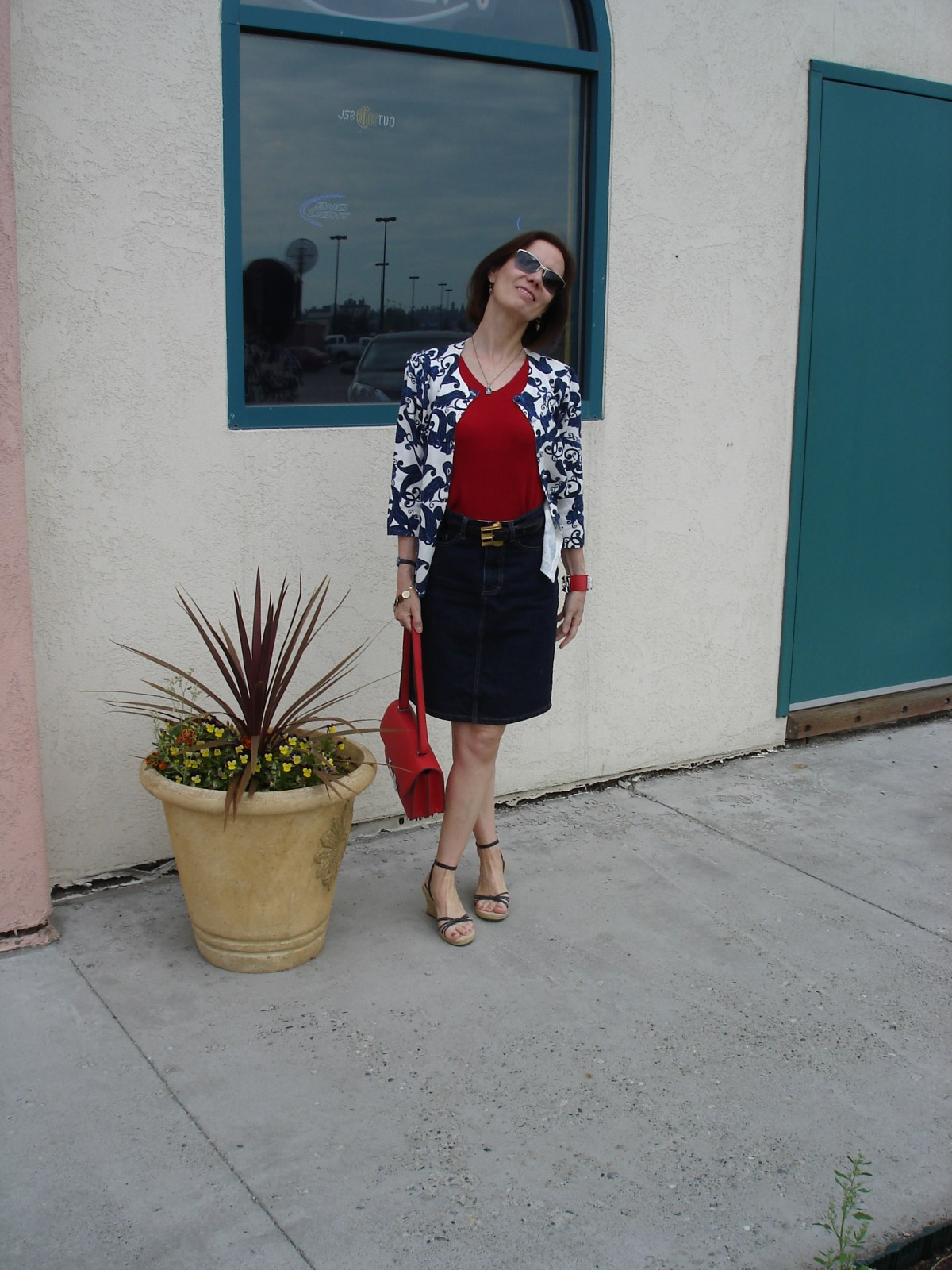 mature woman inpatriotic outfit with skirt and cardigan