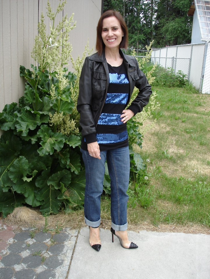 #styleover40 woman looking chic in boyfriends with a sequin striped T-shirt and leather bomber