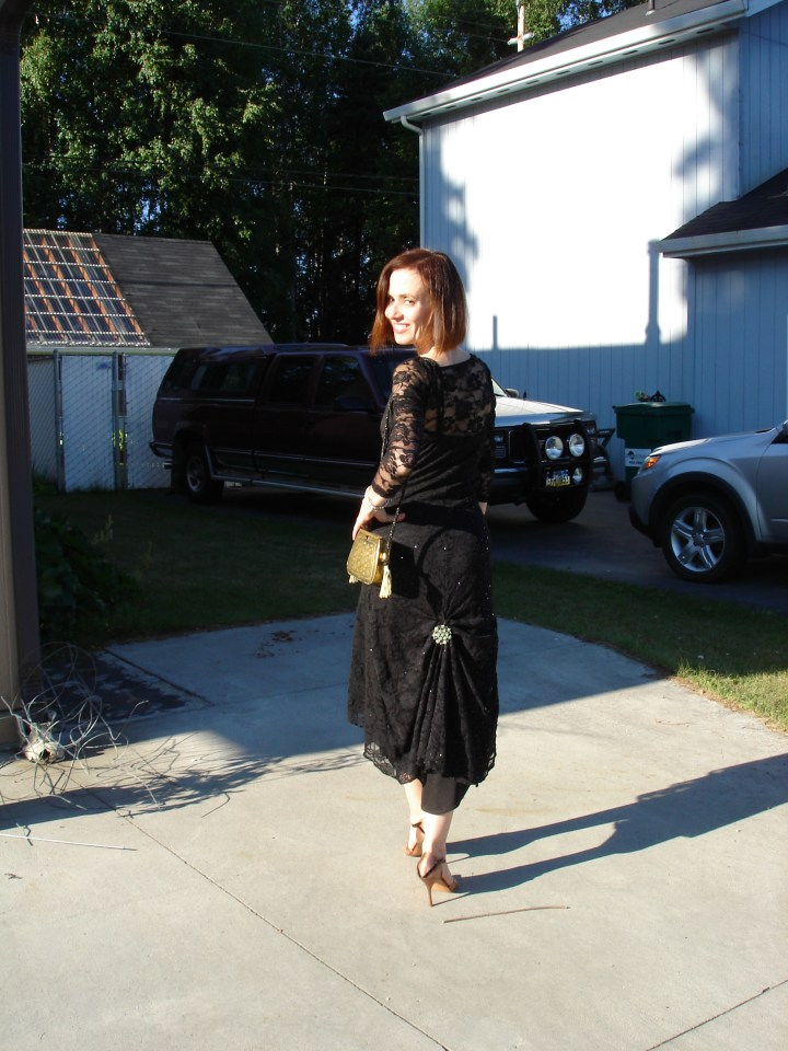 style blogger Nicole in a black lace dress for a semi-formal wedding