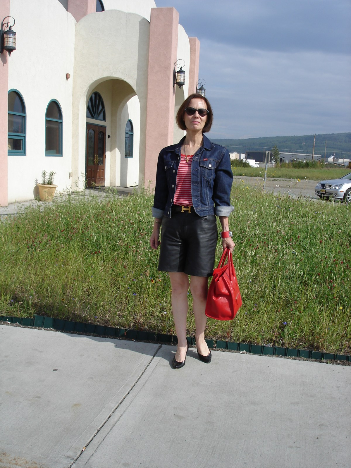 older woman in red, white, blue and black outfit