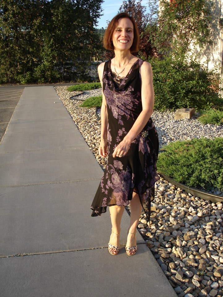 fashion over 50 woman in a semi-formal wedding outfit