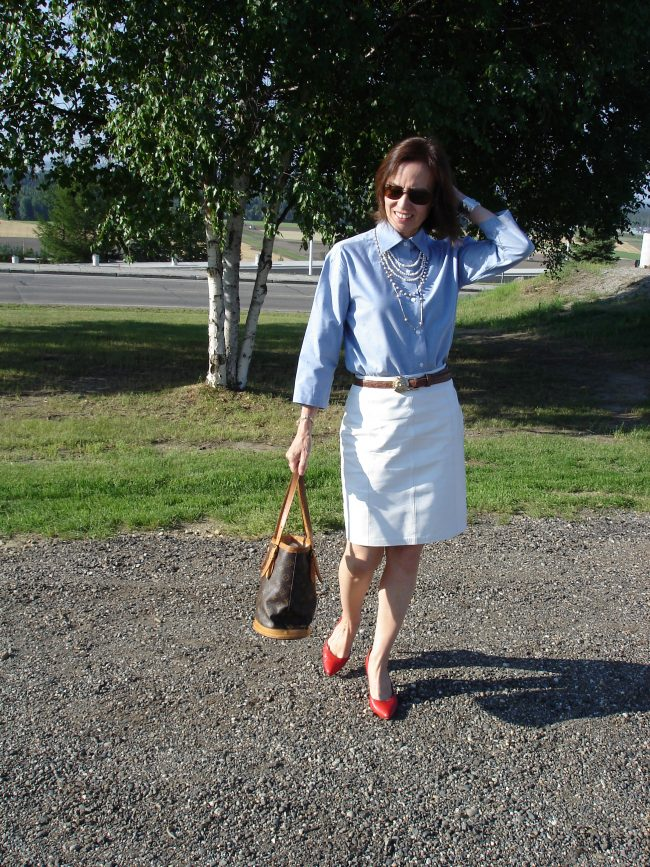 influencer in white straight skirt, red pumps, light blue button-down shirt for the office