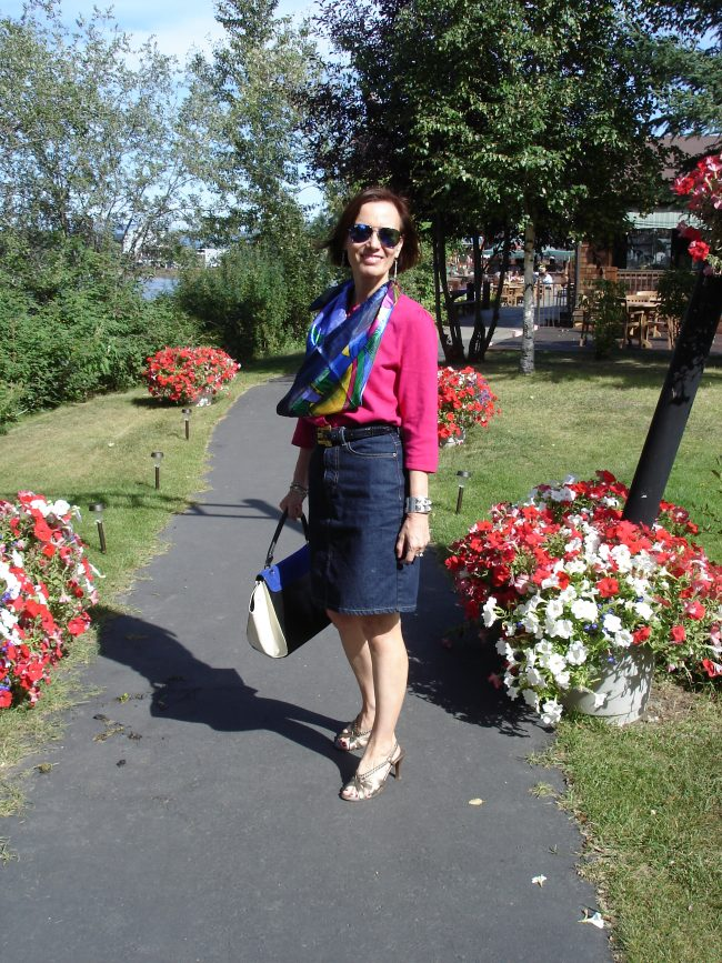 US fashion blogger in button-down shirt with jeans skirt