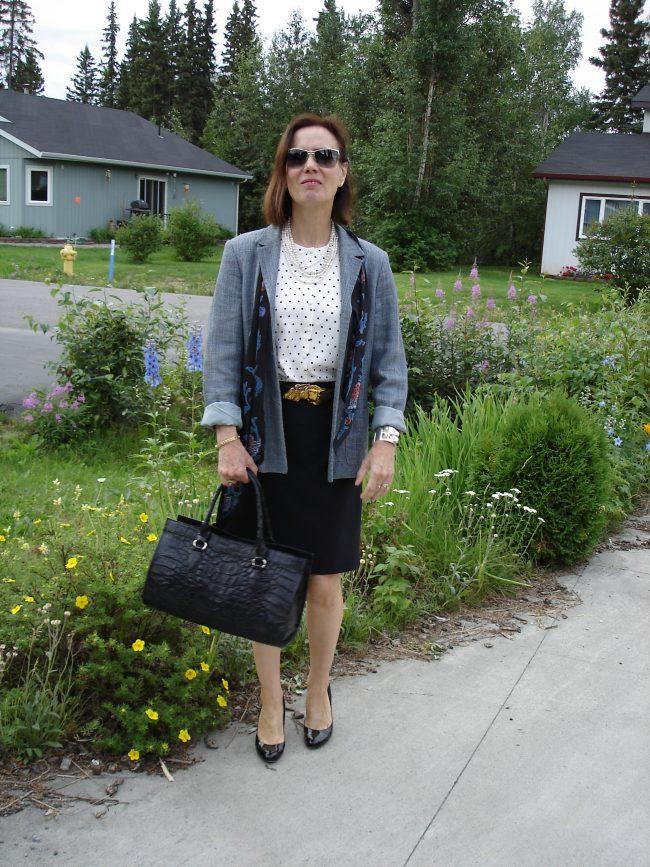 stylist in black skirt with blue blazer separtes