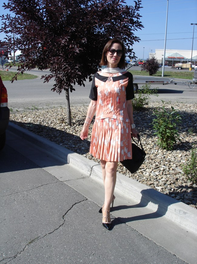 #styleover40 midlife woman in Victoria Victoria Beckham pleated cat dress