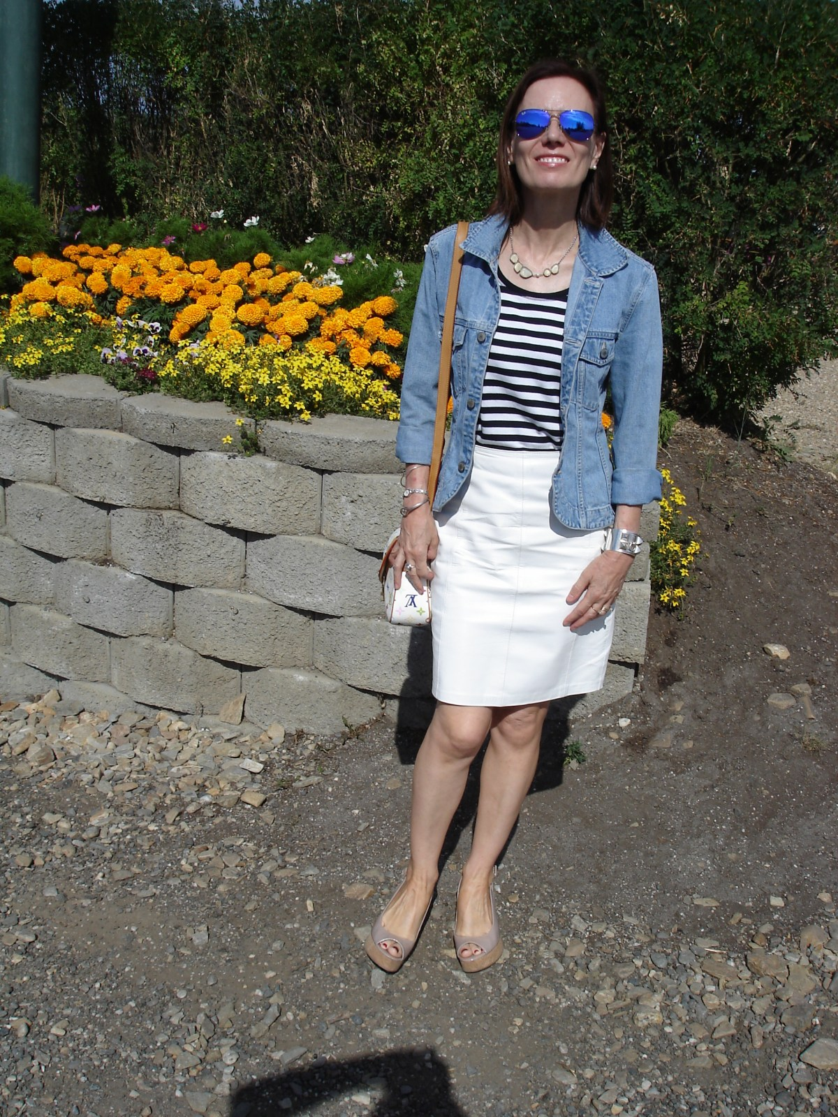 older woman in tailored denim jacket styled for Sunday brunch in summer