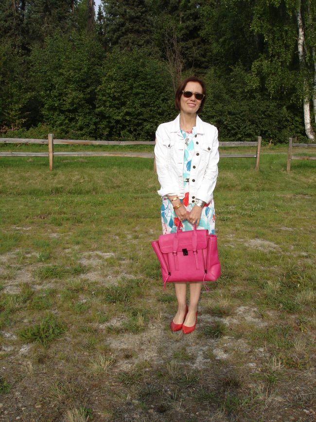 all white printed sheath, white jacket, red pumps, pink bag