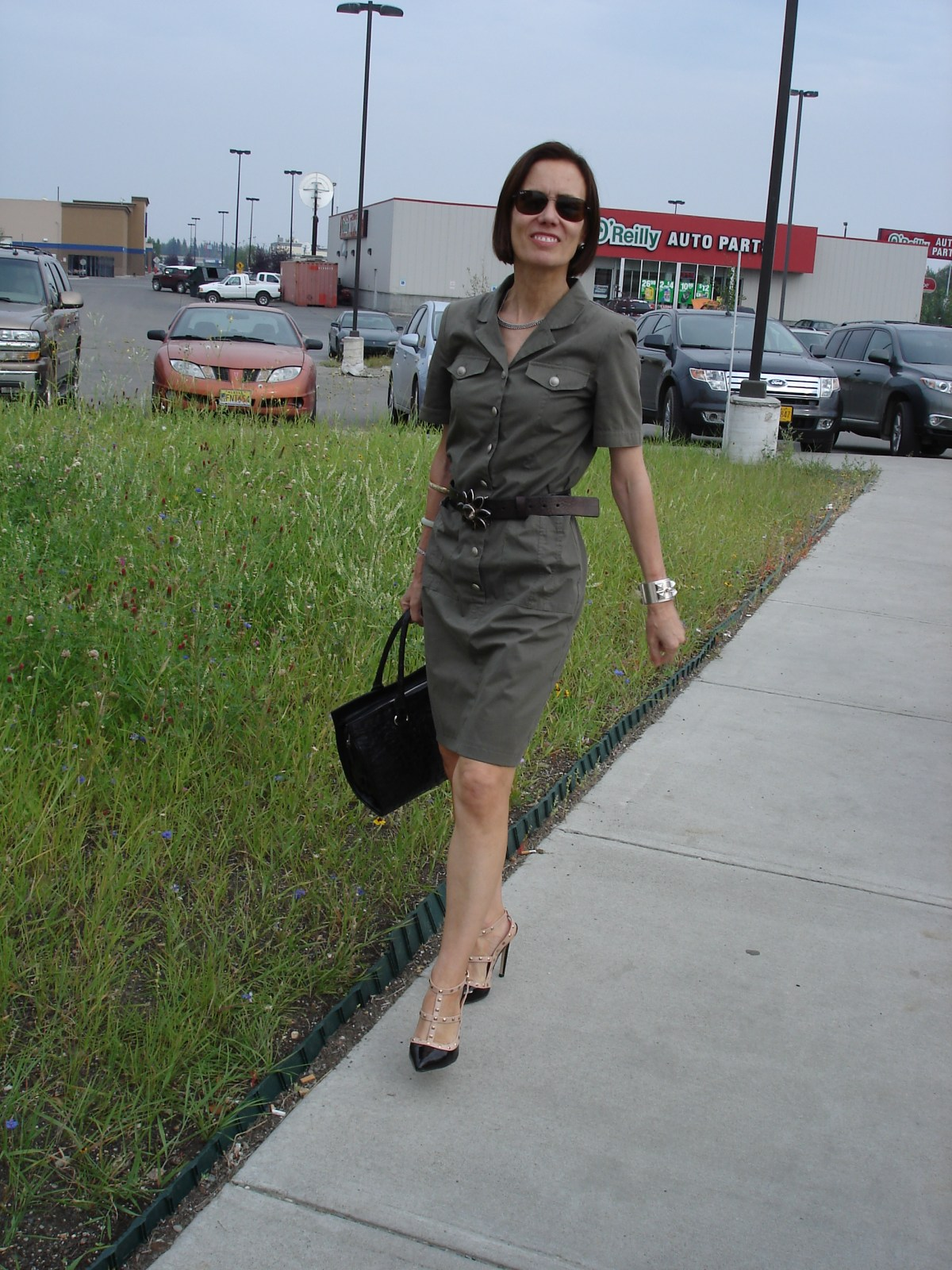 fashion blogger Nicole showing how to look professional during the dog days in a military inspired shirt dress