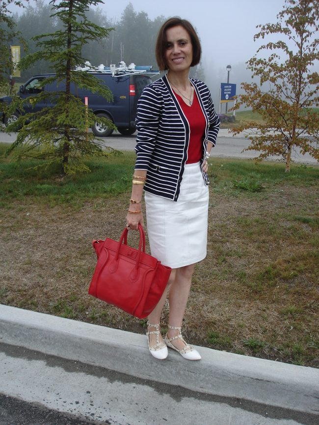 stylist in white skirt, red top, blue stripes jacket