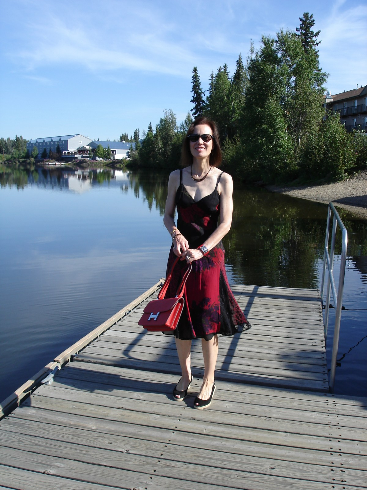 mature style blogger donning a resort sundress