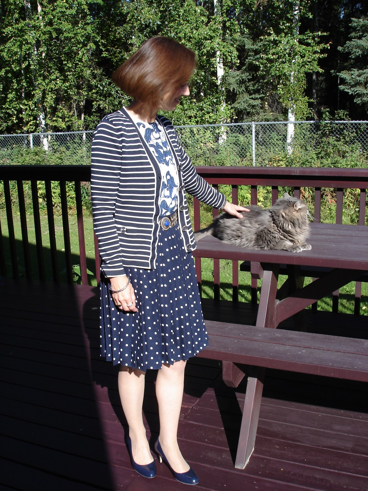 midlife woman in work outfit with consigned items and shoes from eBay