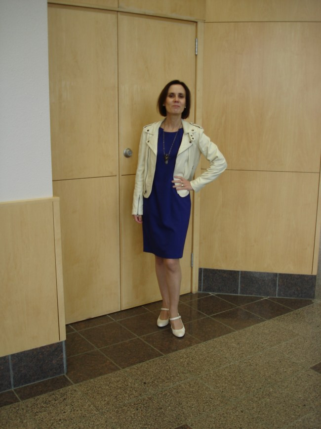 midlife woman in posh chic sheath dress with motorcycle jacket
