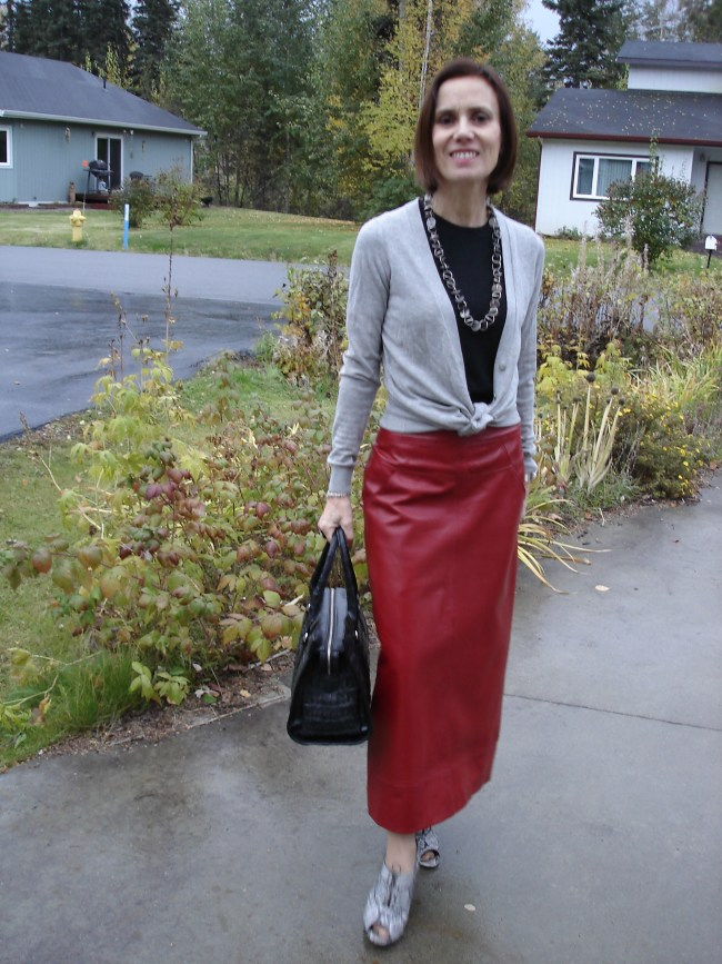stylist with a long red A-line leather skirt with sweater and cardigan