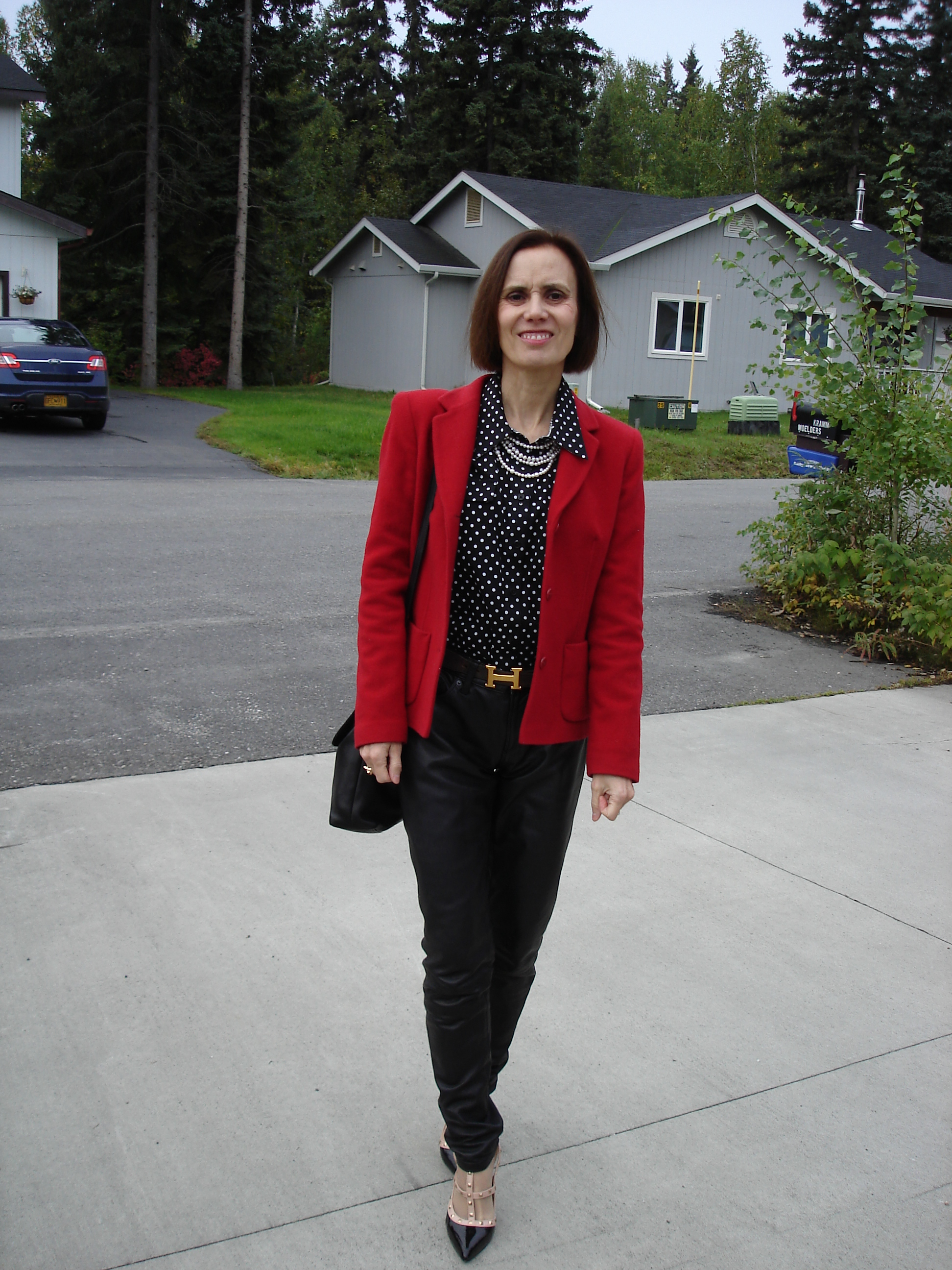 fashion blogger in red, white black business casual look with leather trousers