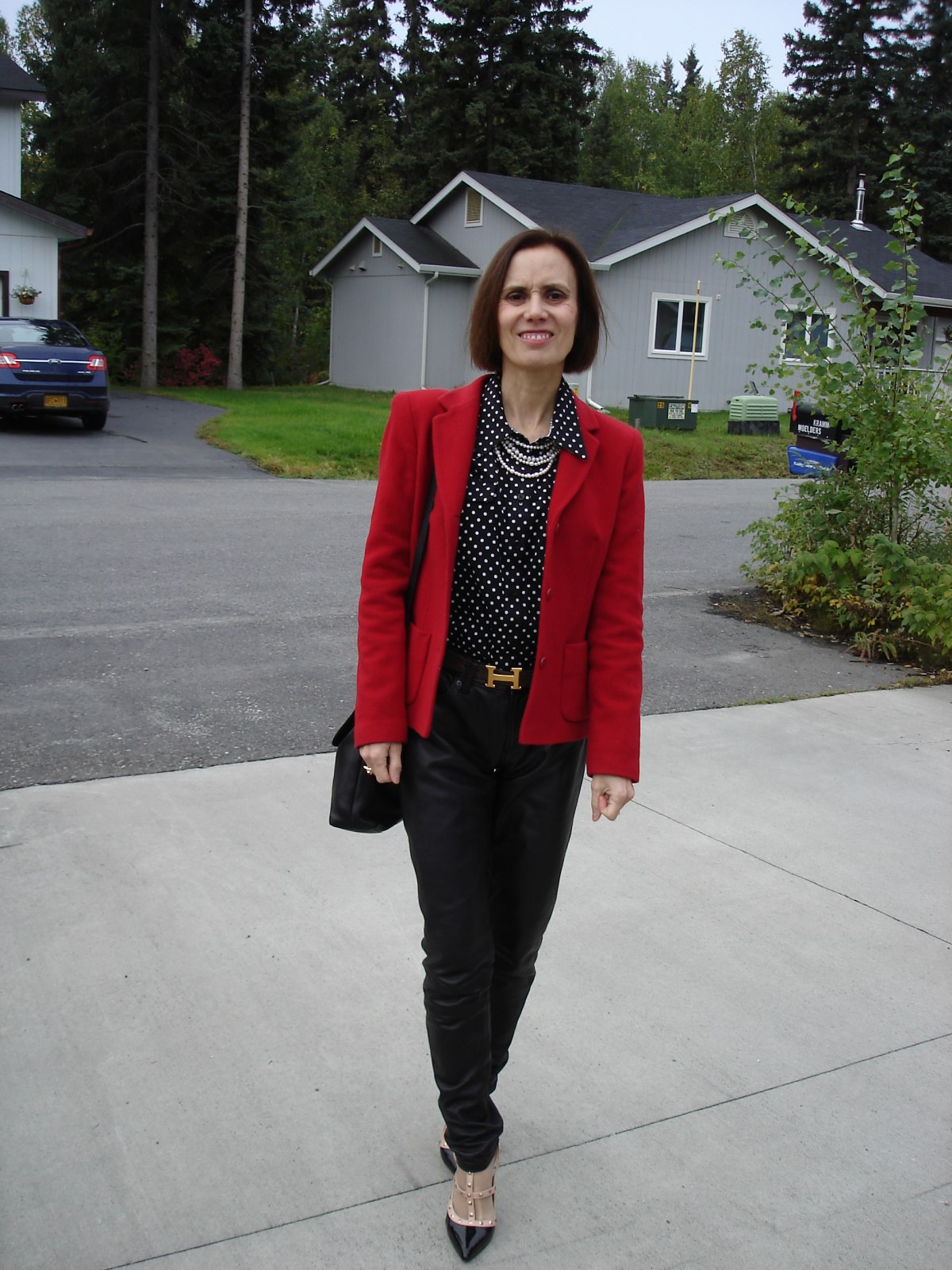 fashion blogger styling fall's trend of leather trousers in red, white black business casual way